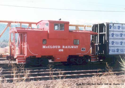Caboose 108 tagged onto the end of a train about to leave Mt. Shasta's SP interchange yard for McCloud