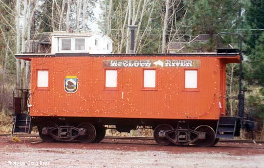 MCR caboose decorated for Christmas at the passenger depot in McCloud